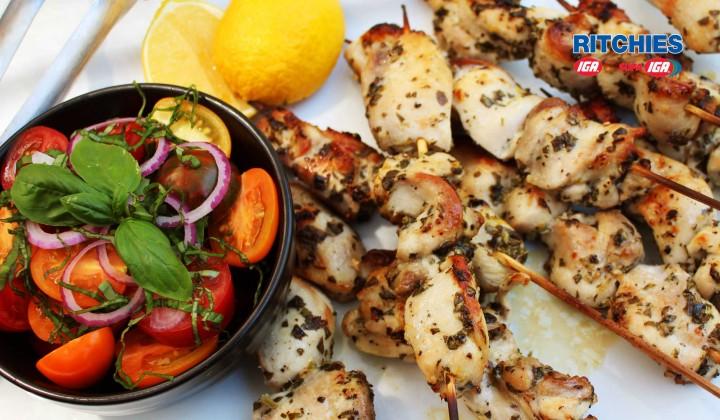 Chicken lemon and oregano kebabs with tomato salad